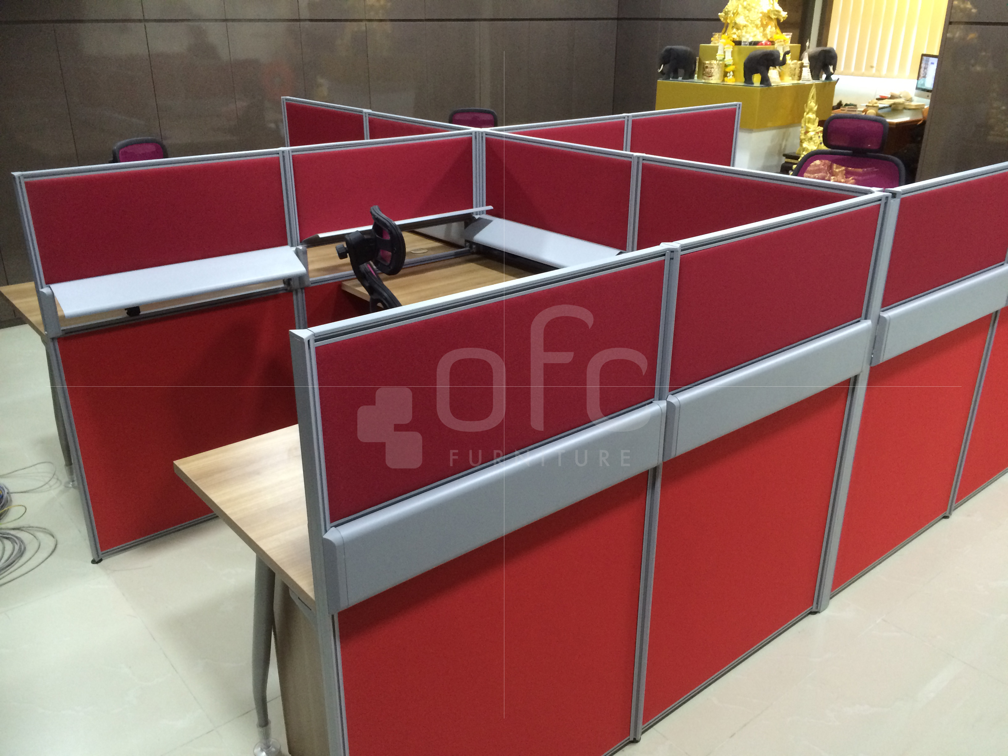 angled office workstation furniture in singapore in red tone